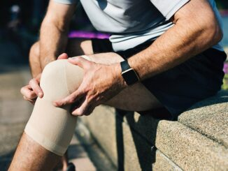 A man have problem of his knee wearing knee pads.