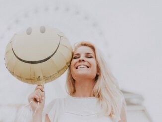 A smiling woman happy with balloon.