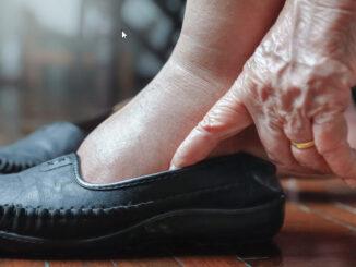 A woman wearing shoe