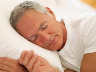 A man sleeping on the bed