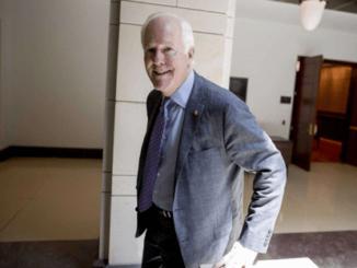 A senior man wearing a suit