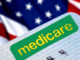"""A word of """"medicare"""" with a American flag behind"""