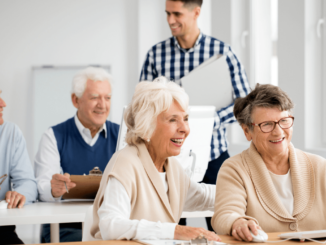 Some senior people have smile and playing computer
