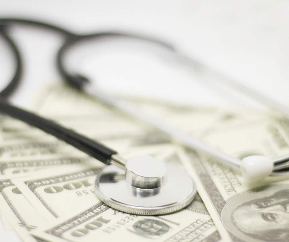 A stethoscope and Us dollars