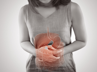 a woman holding her belly and the stomach image