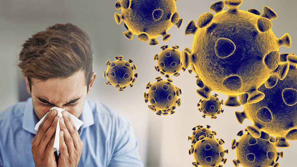 A man sneezing and some virus image beside