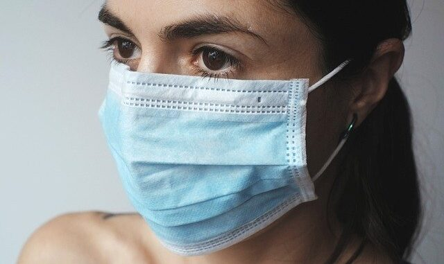 A woman wearing surgical mask.