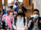 The elementary students wearing face mask in the school.