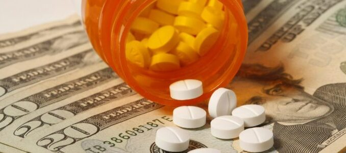 A bottle have many tablets of medicine and US dollars.